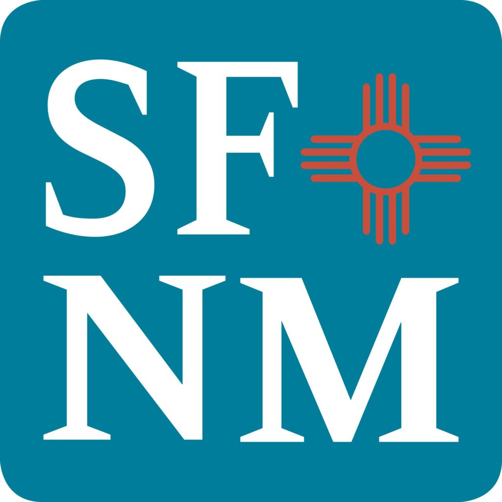 The Santa Fe New Mexican logo featuring white text reading SFNM on medium blue with an orange Zia sun sign design as appears on the New Mexico state flag